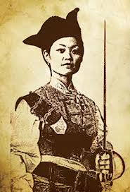 A printing on yellowed paper of a Chinese woman in armor, holding a sword.