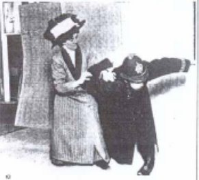 A black and white photo of a woman in Edwardian clothing holding a British police officer in a joint lock