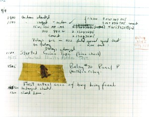 A moth has been taped to a piece of graph paper. Notes describe it as a bug which fell into the machine.
